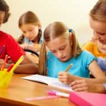 Tuition - girl writing at the centre in Godalming and Cranleigh